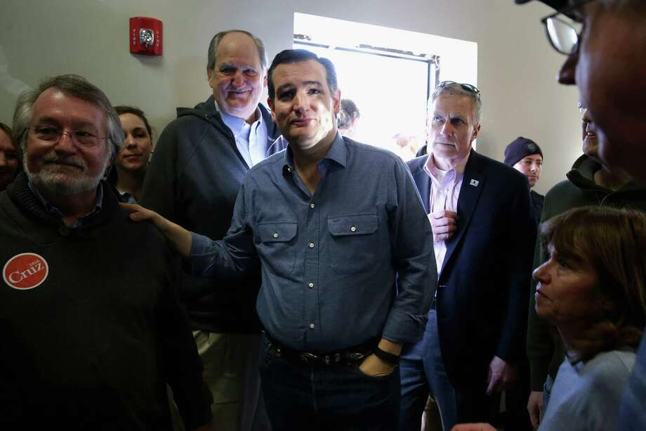 WINDHAM, NH - FEBRUARY 02:  Republican presidential candidate Sen. Ted Cruz (R-TX) (C) is greeted by supporters as he arrives at the Crossing Life Church for a campaign town hall meeting February 2, 2016 in Windham, New Hampshire. Cruz emerged at the top of a crowded GOP presidential field after winning Monday's Iowa caucuses. Photo: Chip Somodevilla, Getty Images / 2016 Getty Images