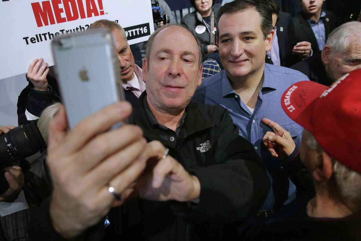 BOW, NH - FEBRUARY 02: Republican presidential candidate Sen. Ted Cruz (R-TX) (R) poses for a selfie with a supporter following a campaign town hall meeting at the Crossing Life Church February 2, 2016 in Windham, New Hampshire. Cruz emerged at the top of a crowded GOP presidential field after winning Monday's Iowa caucuses.