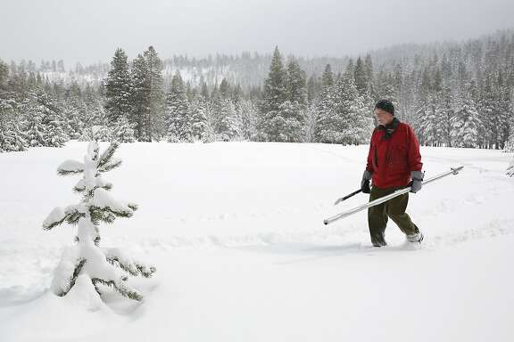 Frank Gehrke, chief of the California Cooperative Snow Surveys Program for the Department of Water Resources, crosses a snow covered meadow after conducting the second manual snow survey of the season at Phillips Station near Echo Summit, Calif., Tuesday, Feb. 2, 2016. The survey showed the snowpack at 130 percent of normal for this site at this time of year. (AP Photo/Rich Pedroncelli)