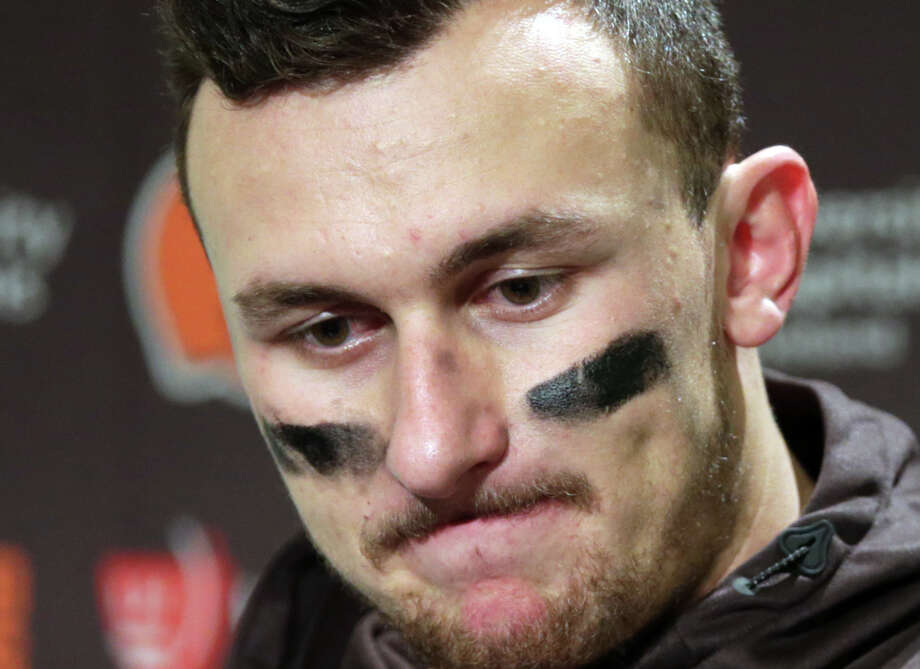 FILE - In this Dec. 20, 2015, file photo, Cleveland Browns quarterback Johnny Manziel speaks with media members following the team's 30-13 loss to the Seattle Seahawks in an NFL football game in Seattle. The Browns said in a statement, Tuesday, Feb. 2, 2016, that Manziel's troubles off the field have undermined his teammates and the organization. (AP Photo/Scott Eklund, File) Photo: Scott Eklund, FRE / FR171040 AP