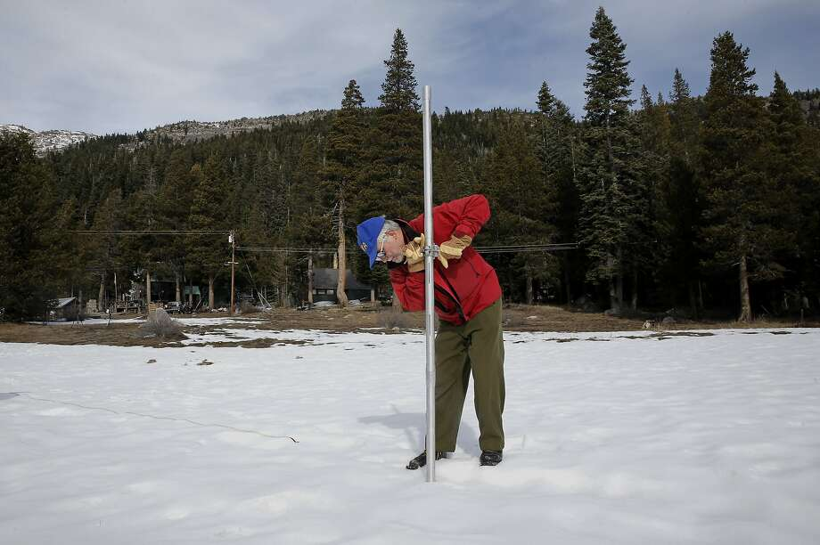 Above: Frank Gehrke, chief of cooperative snow surveys for California's Department of Water Resources, samples the snow depth last January at Phillips Station, when skies were blue and there were patches of brown near Echo Summit off Highway 50. Below: Gehrke and his crew found 76.2 inches of snow Tuesday, with more falling as they made their survey. Photo: Michael Macor, The Chronicle
