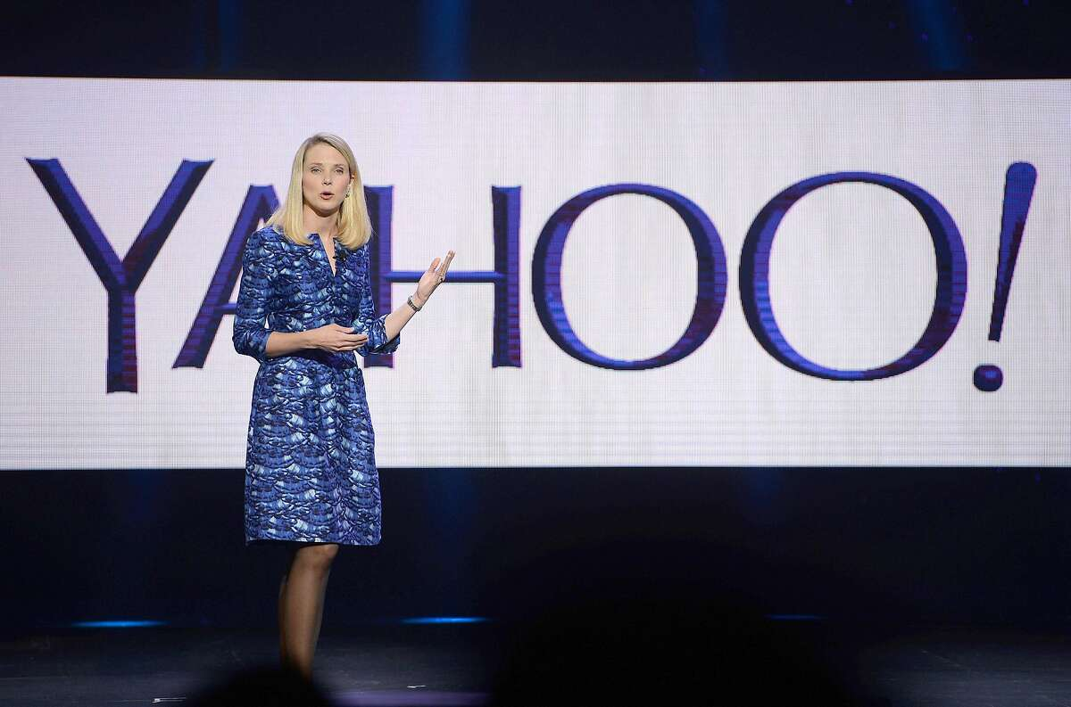 """(FILES) This file photo taken on January 07, 2014 shows Yahoo CEO Marissa Mayer speaking during her keynote address at the 2014 International CES in Las Vegas, Nevada. Yahoo on February 2, 2016 said it is cutting 15 percent of its workforce and narrowing its focus as it explores """"strategic alternatives"""" for what to do with the faded Internet star. The announcements came as the California company reported a loss of $4.43 billion in the final three months of last year, due mostly to lowering the value of its US, Canada, Europe, Latin America and Tumblr units. / AFP / ROBYN BECKROBYN BECK/AFP/Getty Images"""