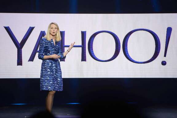 "(FILES) This file photo taken on January 07, 2014 shows Yahoo CEO Marissa Mayer speaking during her keynote address at the 2014 International CES in Las Vegas, Nevada.   Yahoo on February 2, 2016 said it is cutting 15 percent of its workforce and narrowing its focus as it explores ""strategic alternatives"" for what to do with the faded Internet star. The announcements came as the California company reported a loss of $4.43 billion in the final three months of last year, due mostly to lowering the value of its US, Canada, Europe, Latin America and Tumblr units.  / AFP / ROBYN BECKROBYN BECK/AFP/Getty Images"