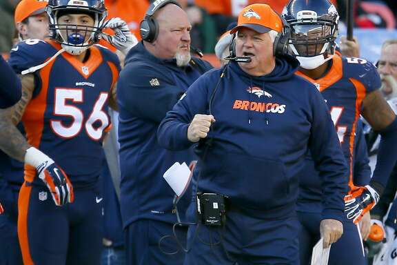 FILE - In this Dec. 13, 2015, file photo, Denver Broncos defensive coordinator Wade Phillips pumps his fist during the first half of an NFL football game against the Oakland Raiders in Denver. The Broncos defensive coordinator is a character cut from the same cloth as his dad, quick with a quip and as good a teacher as he is a tactician. (AP Photo/Joe Mahoney, File)