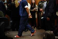 """One of three underage suspects in last week's shooting rampage at """"The Jungle"""" homeless encampment speaks enters the courtroom for his first appearance in juvenile court, Tuesday, Feb. 2, 2016. Judge Regina Cahan ruled to keep all three suspects detained until further court proceedings."""