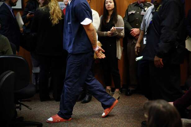 "One of three underage suspects in last week's shooting rampage at ""The Jungle"" homeless encampment speaks enters the courtroom for his first appearance in juvenile court, Tuesday, Feb. 2, 2016. Judge Regina Cahan ruled to keep all three suspects detained until further court proceedings."