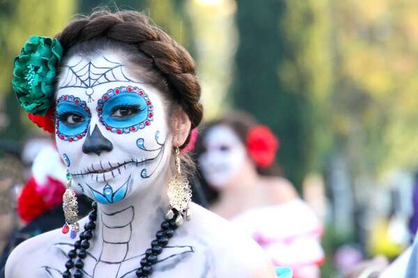 "A blue-accented Catrina (""Dapper Skeleton,"" ""Elegant Skull,"" ""Elegant Death"") at a Dia de los Muertos (Day of the Dead) celebration in Los Angeles in October 2011."