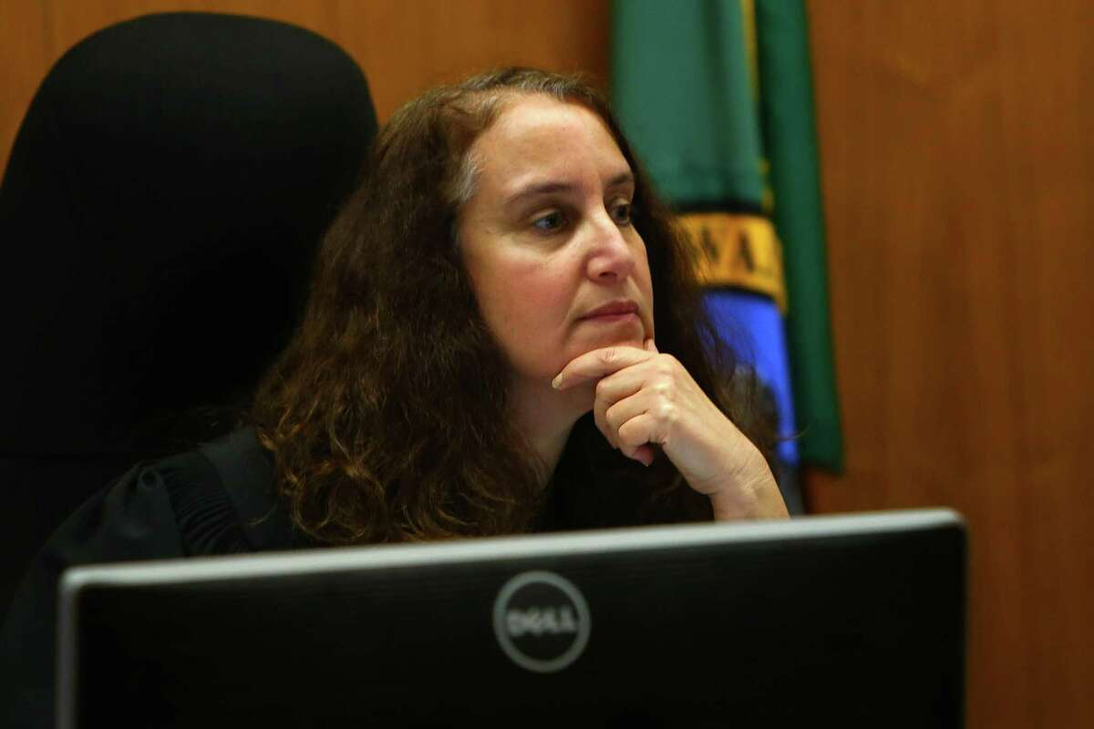 Juvenile court Judge Regina Cahan conducts first appearance proceedings for three underage suspects arrested in connection with last week's shooting at