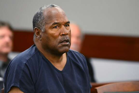 FILE - In this May 14, 2013, file photo, O.J. Simpson appears at an evidentiary hearing in Clark County District Court in Las Vegas. A lawyer for Simpson says the imprisoned former football star isn't happy with ads and interviews about a cable TV series focusing on his 1995 murder acquittal in Los Angeles, but he's not upset about the way he's depicted. (Ethan Miller via AP, Pool)