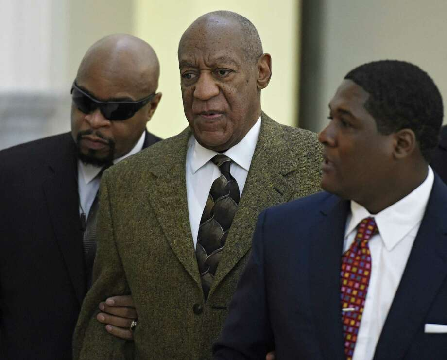 Actor and comedian Bill Cosby, center, arrives for a court appearance Tuesday, Feb. 2, 2016, in Norristown, Pa. Cosby was arrested and charged with drugging and sexually assaulting a woman at his home in January 2004. (Clem Murray/The Philadelphia Inquirer via AP, Pool)  ORG XMIT: PAPHQ203 Photo: Clem Murray / The POOL Philadelphia Inquirer