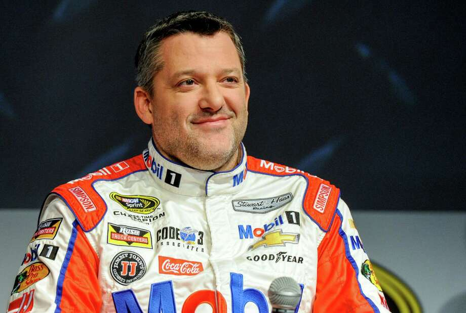 FILE - In this Thursay, Jan. 21, 2016, file photo, Stewart Haas Racing co-owner and driver Tony Stewart talks to members of the media during the NASCAR Charlotte Motor Speedway Media Tour in Charlotte, N.C. The three-time NASCAR champion has been hospitalized with a back injury after a non-racing accident on Sunday and Stewart-Haas Racing is unsure of the extent of his injuries, a team spokesman told The Associated Press, Tuesday, Feb. 2, 2016. (AP Photo/Mike McCarn, File) ORG XMIT: NY169 Photo: Mike McCarn / FR34342 AP