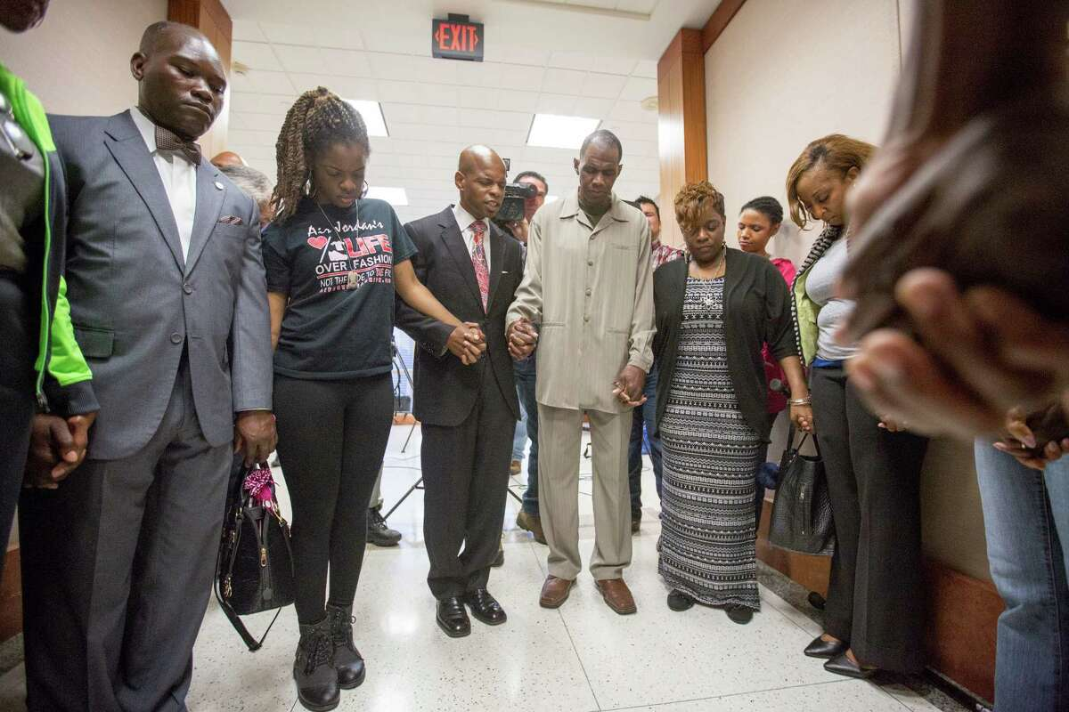 Muhammad leads supporters of Joshua Woods in prayer at the Harris County Criminal Courthouse in February.