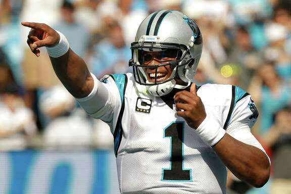 Carolina Panthers quarterback Cam Newton (1) celebrates his 2-yard touchdown run against the Houston Texans during the third quarter of an NFL football game at Bank of America Stadium on Sunday, Sept. 20, 2015, in Charlotte. ( Brett Coomer / Houston Chronicle )
