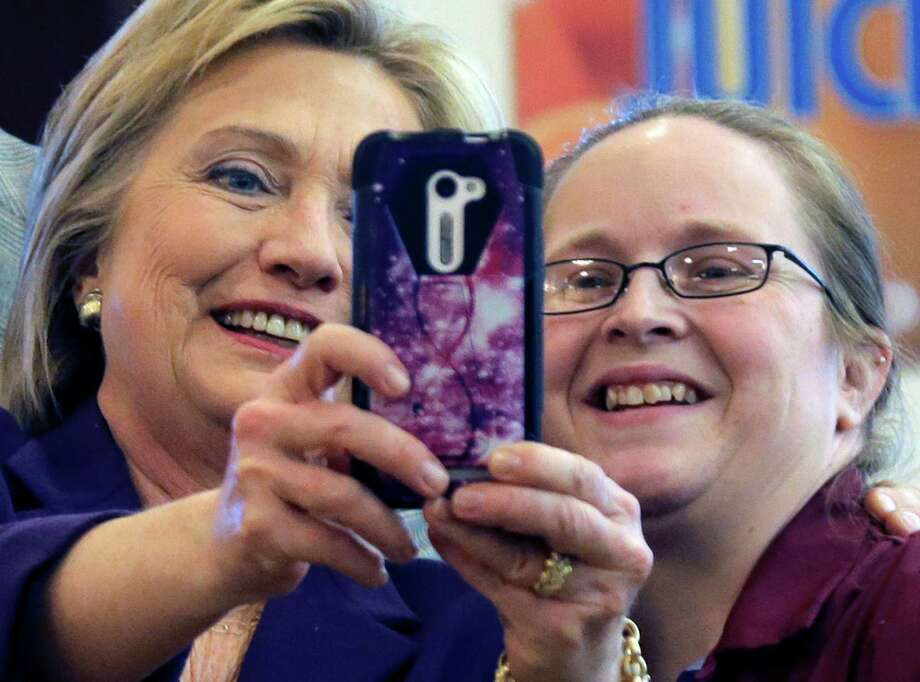 Democratic presidential candidate Hillary Clinton takes a selfie in Manchester, N.H. Her supporters are concerned about her struggle to attract young voters. Photo: Elise Amendola, STF / AP