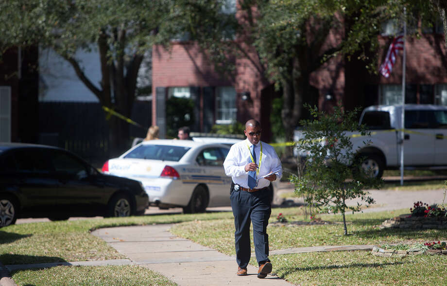 Authorities investigate the scene where two people were reportedly found dead of apparent gunshot wounds Tuesday at a home on Crooks Way Court near Churchill Way Drive in northwest Harris County. Photo: Cody Duty, Staff / © 2015 Houston Chronicle