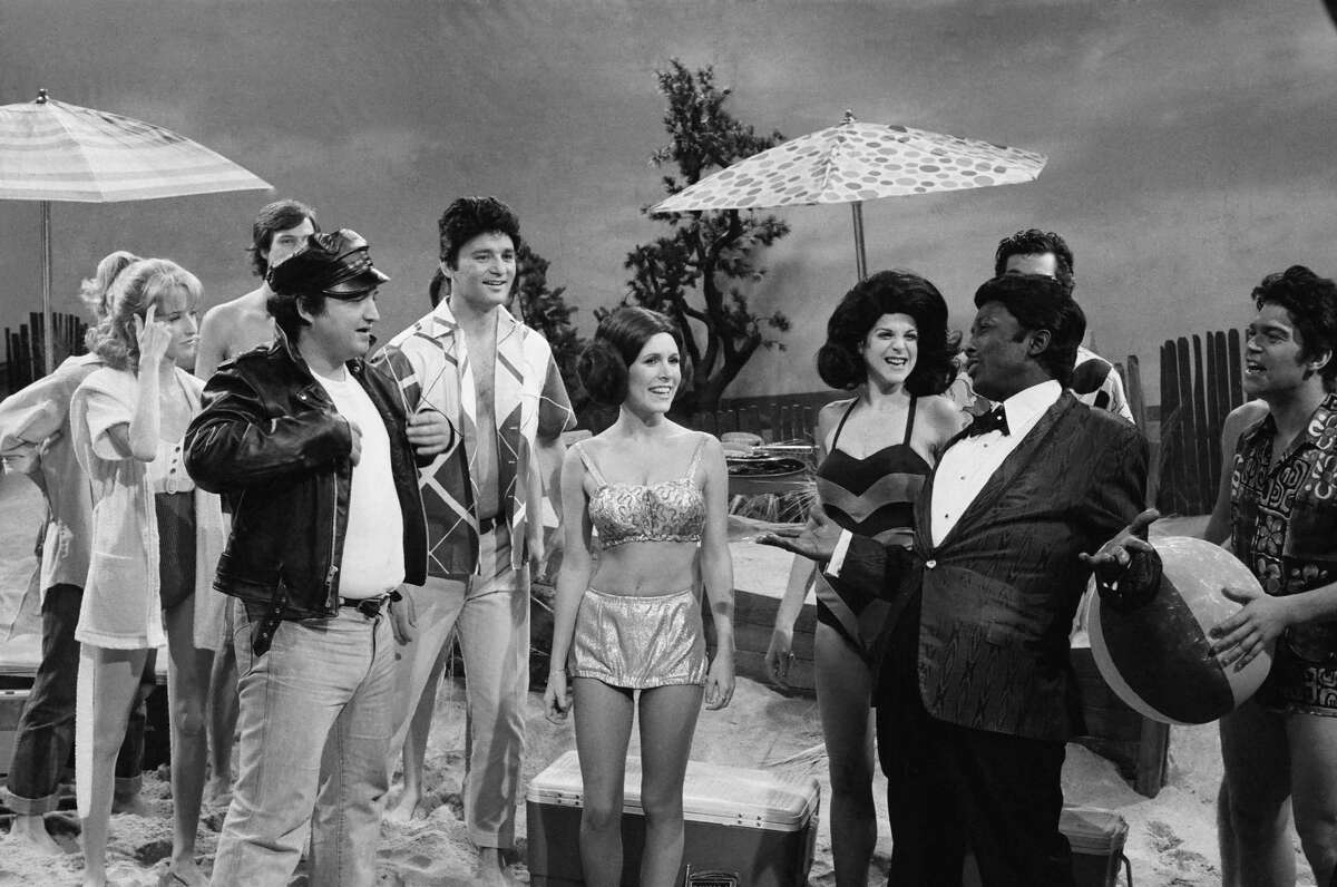 SATURDAY NIGHT LIVE -- Episode 6 -- Air Date 11/18/1978 -- Pictured: (l-r) John Belushi as Eric Von Zipper, Bill Murray as Frankie Avalon, Carrie Fisher as Princess Leia, Gilda Radner as Annette Funicello, Garrett morris as Chubby Checker during 'Beach Blanket Bimbo from Outer Space' skit on November 18, 1978