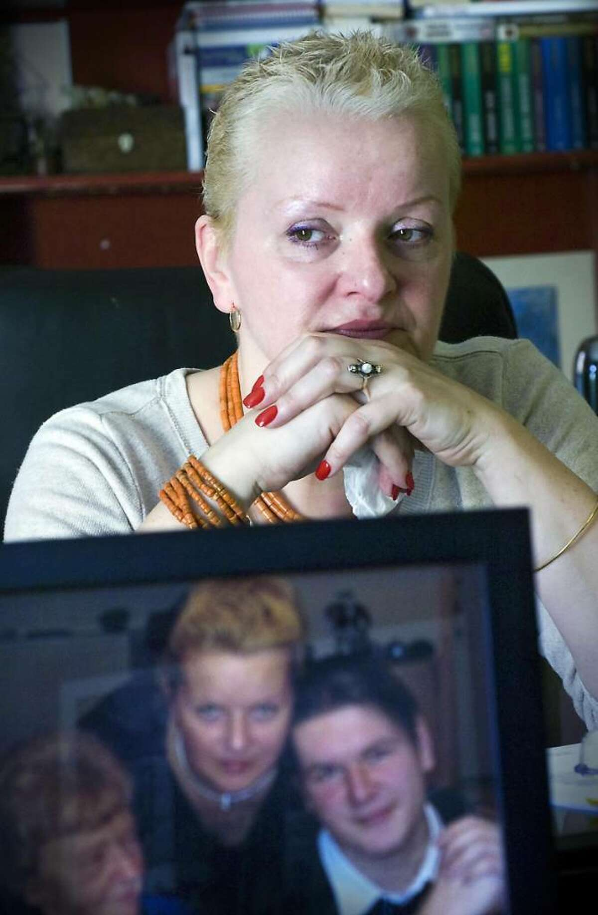 """Barbara Green recently filed a complaint to the Federal Highway Traffic Safety Administration that sudden acceleration in her son Blazej Ignatowicz's 2000 Toyota Solara caused a fatal accident on Dec. 1, 2006. She sits in her home with pictures of her late son """"Blaze"""" in Stamford, Conn. on Thursday April 1, 2010"""