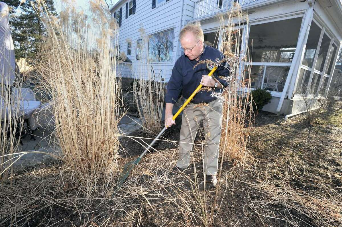 Mayor Mark Boughton has started the spring clean-up process in the yard of his home on Alan Road. in Danbury. Boughton is a Republican gubernatorial candidate.