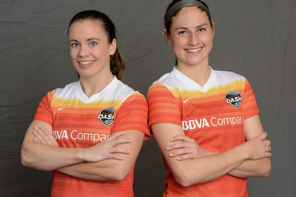 Dash defender Allysha Chapman (left) and rookie forward Janine Beckie moedel the team's new uniforms.
