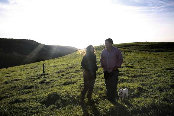Claire Herminjard of Mindful Meats and rancher-owner David Evans of Marin Sun Farms show the ranch in Inverness, California, on Monday,  February 1, 2016.