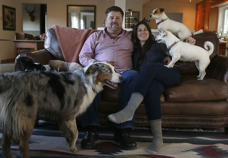 Claire Herminjard of Mindful Meats and rancher-owner David Evans of Marin Sun Farms introduce their dogs at home in Inverness, California, on Monday,  February 1, 2016.