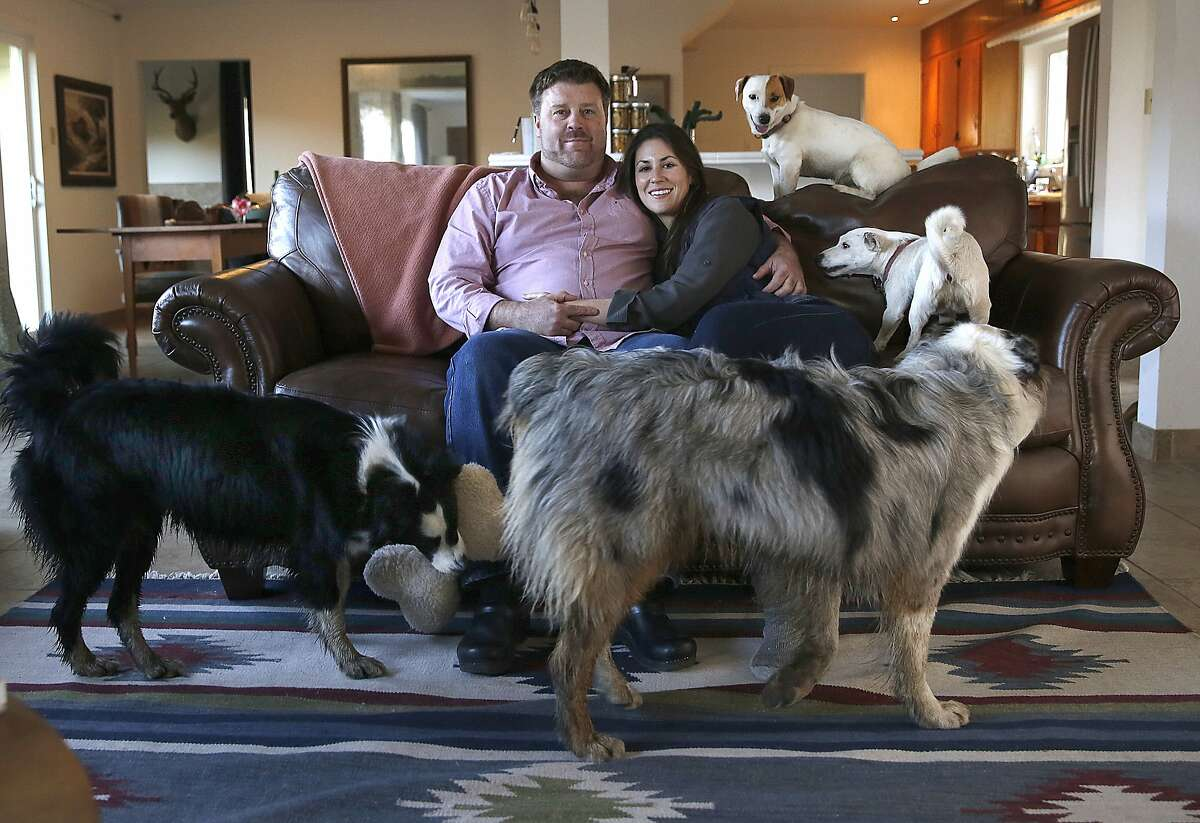 Claire Herminjard of Mindful Meats and rancher-owner David Evans of Marin Sun Farms at home with four of their dogs in Inverness.