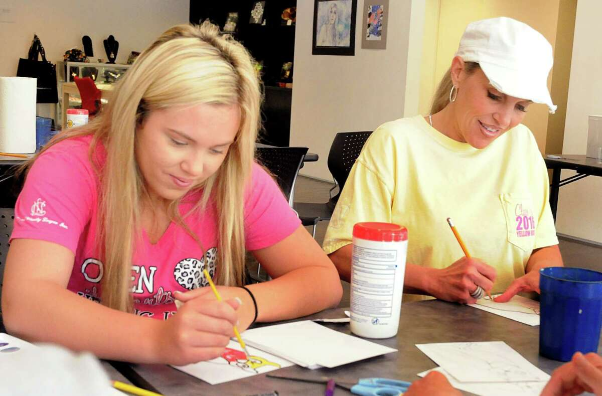 Madison Dubiski and her mom, Michelle, worked on an art project during Family Day last year at the Pearl Fincher Museum of Fine Arts in Spring.