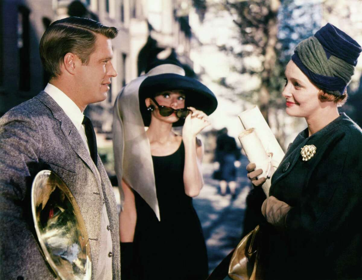 """In this image released by Paramount Pictures, George Peppard, left, Audrey Hepburn and Patricia Neal, right, are shown in a scene from, """"Breakfast at Tiffany's."""" (AP Photo/Paramount Pictures) ** NO SALES **"""