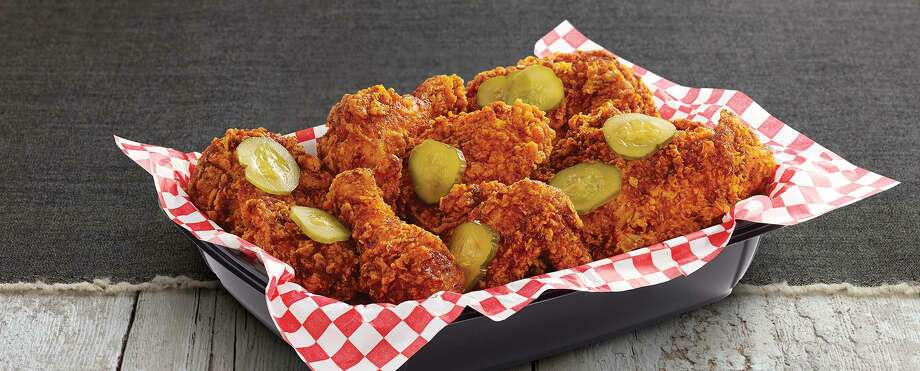 """Nashville Hot  Chicken from KFC: Three  KFC extra crispy boneless tenders slathered in Nashville-style sauce, a  few pickle slices on top, a side of coleslaw and a buttermilk biscuit.Total calories: 880 (for the chicken, slaw and biscuit). Fat grams: 55. Sodium: 2,130 mg. Carbs: 61 g. Dietary fiber: 4 g. Protein: 38 gWhat Hoffman says:KFC introduced Nashville Hot Chicken in a test run last year in  Pittsburgh and reported """"the most successful product testing in the  company's recent history."""" You know what they say, as Pittsburgh goes,  so goes the nation. OK, Ohio. This is great stuff. Really. And don't even think about trying to make this at home. It's too much work.Click here to read the full review. Photo: KFC"""