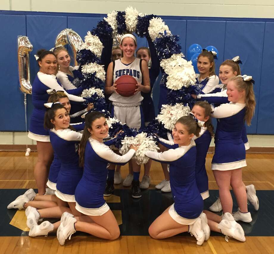 Shepaug Valley senior Caroline Kelly is surrounded by cheerleaders after scoring her 1,000th career point last week. Photo: Contributed Photo