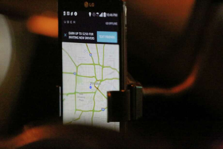 A controversial system used by Uber to evade regulators was not successful, if used, in Houston, city officials said. From February to December, city regulators wrote 2,910 citations to local drivers using a smartphone app to connect with riders. Photo: Jon Shapley, Houston Chronicle / © 2015 Houston Chronicle