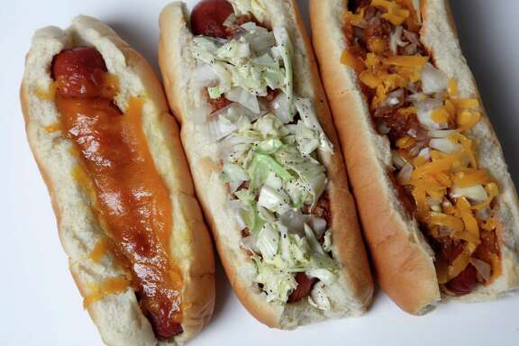 A bacon wrap dog, Carolina dog and chili dog from Pugel's, 3502 N. St. Mary's St.
