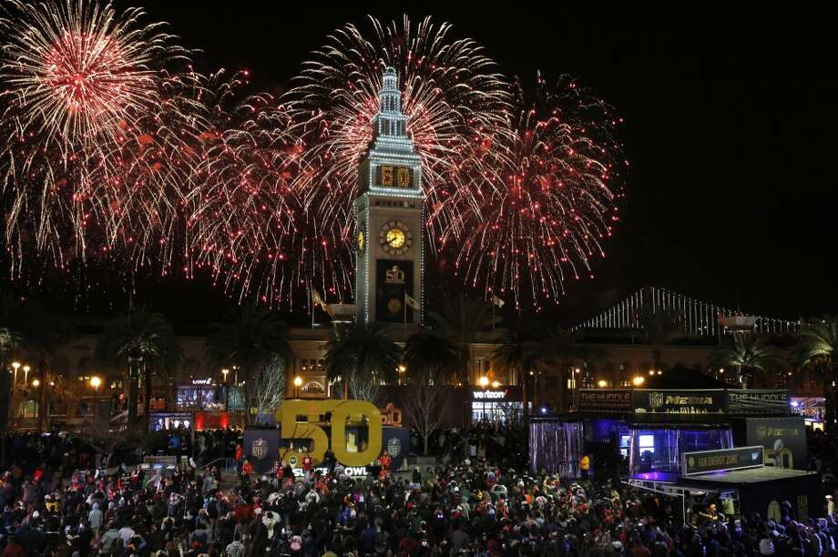 More from Super Bowl City: Fireworks go off behind the Ferry Building on the opening night of events for the Super Bowl City Jan. 30, 2016 in San Francisco, Calif. Photo: Leah Millis, The Chronicle