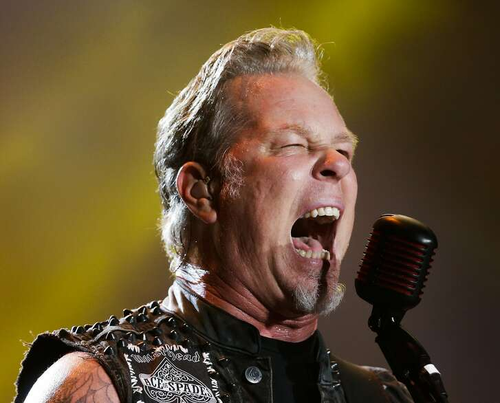 FILE - In this Sept. 20, 2015 file photo, James Hetfield of Metallica  performs at the Rock in Rio music festival in Rio de Janeiro, Brazil. The Super Bowl takes place a week before the Grammys, but the big game is rivaling the awards shows with a plethora of live concerts and on-site musicians, from the Red Hot Chili Peppers and Metallica to Pharrell and Skrillex. (AP Photo/Felipe Dana, File)