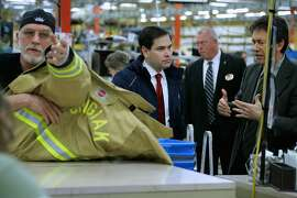 PITTSFIELD, NH - FEBRUARY 03:  Republican presidential candidate Sen. Marco Rubio (R-FL) (C) is given a tour of Globe Manufacturing by President and CEO Don Welch (R) before holding a town hall event with employees February 3, 2016 in Pittsfield, New Hampshire.  Globe Manufacturing has created life-saving gear for thousands of emergency workers in over 80 countries for more than 100 years. Rubio is hoping to gather momentum in New Hampshire after placing third in Monday's Iowa caucuses, finishing one percentage point behind Donald Trump and four points behind the leader, Sen. Ted Cruz (R-TX).  (Photo by Chip Somodevilla/Getty Images)