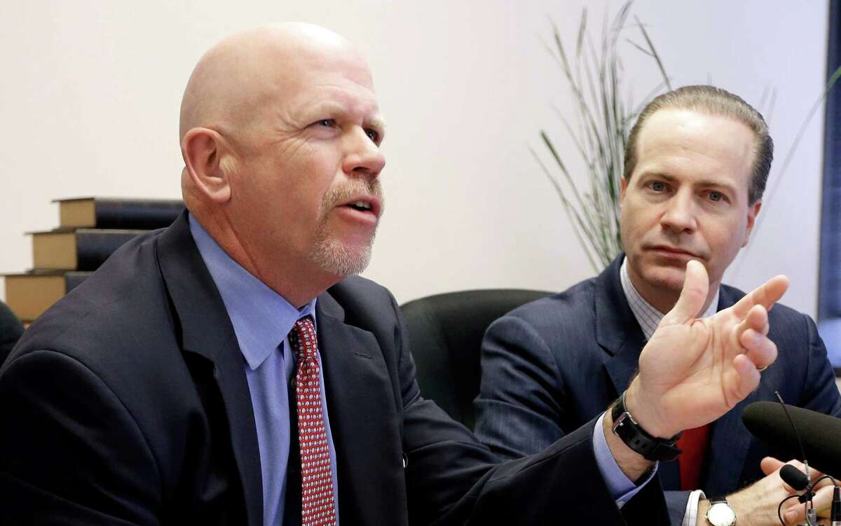 Attorney Terry Yates, left, answers a question as fellow attorney Jared Woodfill listens during a news conference Wednesday, Jan. 27, 2016, in Houston. Both attorneys represent David Daleiden and Sandra Merritt who are accused of using fake driver's licenses to infiltrate the nation's largest abortion provider in order to make videos that accused Planned Parenthood of illegally selling fetal tissue to researchers for profit. (AP Photo/David J. Phillip)
