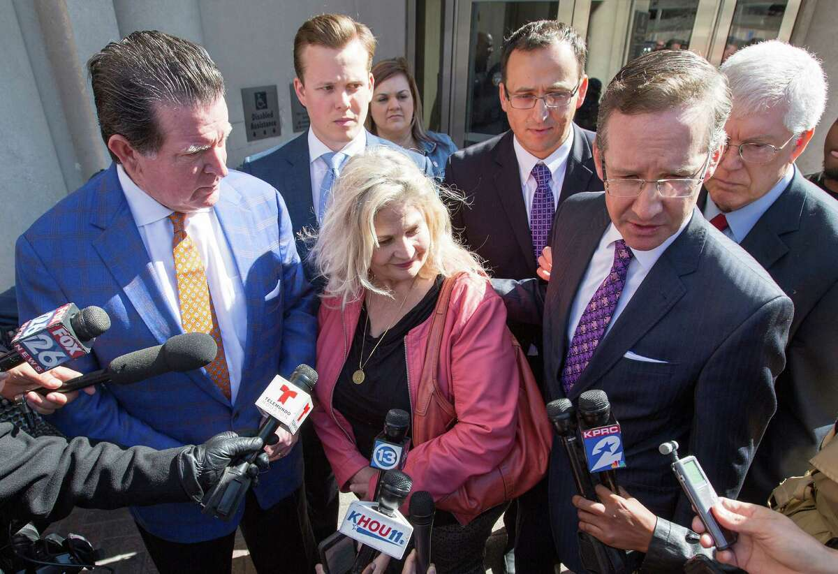 Sandra Merritt, center, listens as her attorneys answer questions outside the Harris County Criminal Courthouse, Wednesday, Feb. 3, 2016, in Houston. The pro-life activist was one of two people indicted by a Harris County grand jury on charges that they faked government documents in a video sting aimed at Planned Parenthood.