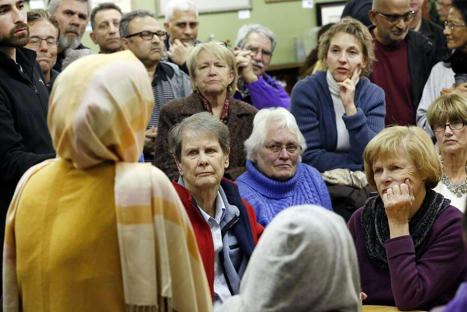 "Attendees listen as group organizer Moina Shaiq, left, speaks during a ""Meet a Muslim Community Conversation"", a public gathering designed to build bridges with the Muslim community, held at the Mission Coffee Roasting Company in Fremont, CA Monday, February 1, 2016. Photo: Michael Short, Special To The Chronicle"