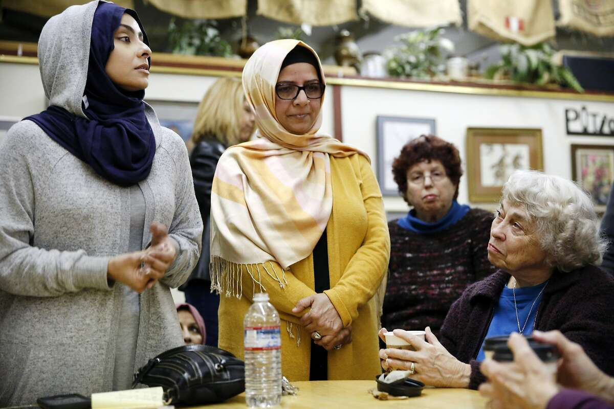 """Group organizers Jehan Hakim, left, and Moina Shaiq listen to questions from community members during a """"Meet a Muslim Community Conversation"""", a public gathering designed to build bridges with the Muslim community, held at the Mission Coffee Roasting Company in Fremont, CA Monday, February 1, 2016."""