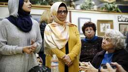"Group organizers Jehan Hakim, left, and Moina Shaiq listen to questions from community members during a ""Meet a Muslim Community Conversation"", a public gathering designed to build bridges with the Muslim community, held at the Mission Coffee Roasting Company in Fremont, CA Monday, February 1, 2016."