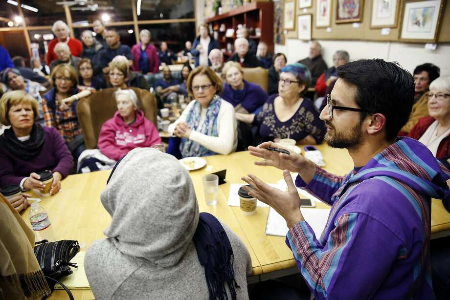 "Group member Azam Khan of Fremont answer a question during a ""Meet a Muslim Community Conversation"", a public gathering designed to build bridges with the Muslim community, held at the Mission Coffee Roasting Company in Fremont, CA Monday, February 1, 2016. Photo: Michael Short, Special To The Chronicle"