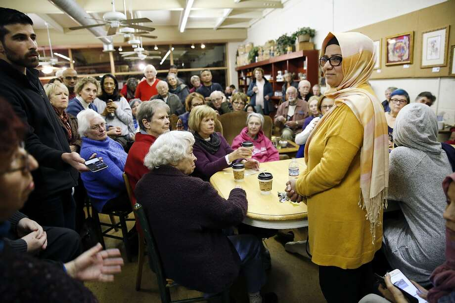 "Group organizer Moina Shaiq, right, listenns to a question from the audience  during a ""Meet a Muslim Community Conversation"", a public gathering designed to build bridges with the Muslim community, held at the Mission Coffee Roasting Company in Fremont, CA Monday, February 1, 2016. Photo: Michael Short, Special To The Chronicle"