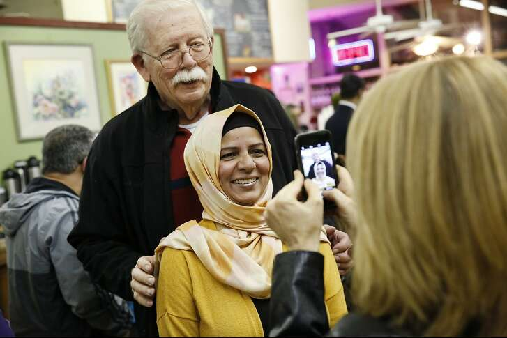 "Group organizer Moina Shaiq poses for a picture with former Fremont mayor Gus Morrison following a ""Meet a Muslim Community Conversation"", a public gathering designed to build bridges with the Muslim community, held at the Mission Coffee Roasting Company in Fremont, CA Monday, February 1, 2016."