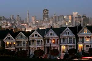 """In this Monday, May 12, 2008 file photo, the """"Painted Ladies,"""" a row of historical Victorian homes, underscore the San Francisco skyline in a view from Alamo Square.   Real estate brokerage Redfin analyzed home sales over the past 24 months in 20 major U.S. cities, breaking down the data by neighborhood. Many of the cities reflect home values that have outpaced wages over the past 15 years, causing their neighborhoods to mirror a broader national wealth gap. San Francisco, for example, enjoys the benefits of tech fortunes, but its homes are largely unaffordable for the police officers, firefighters and teachers the city needs. (AP Photo/Marcio Jose Sanchez)"""
