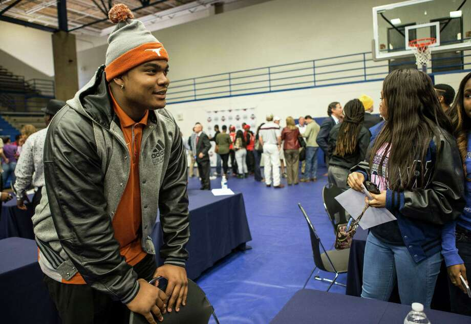 Westside's Jordan Elliott stands at a table following the Houston Independent School District's National Signing Day ceremonies at the Mark Anthony Pavilion on Wednesday, Feb. 3, 2016, in Houston. Elliott signed a letter of intent to play football at Texas. Photo: Brett Coomer, Houston Chronicle / © 2016 Houston Chronicle