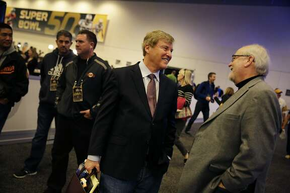 Leigh Steinberg (l to r), catches up with  Joseph Horrigan, with the Pro Football Hall of Fame, between interviews at the media center at  Moscone West on Wednesday, February 3, 2016 in San Francisco, Calif.