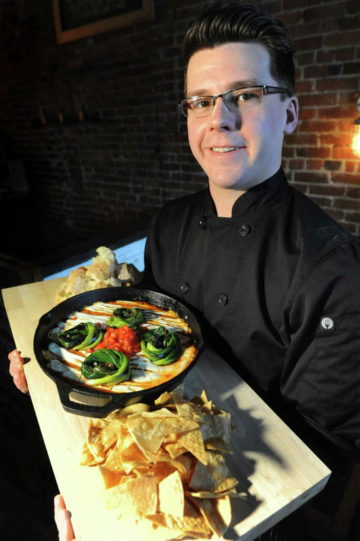 Chef Rich Matthews and his Bacon Remesco Dip with goat cheese sour cream and served with tortilla chips and bread on Thursday, Jan. 28, 2016, at The Shop in Troy, N.Y. (Cindy Schultz / Times Union)