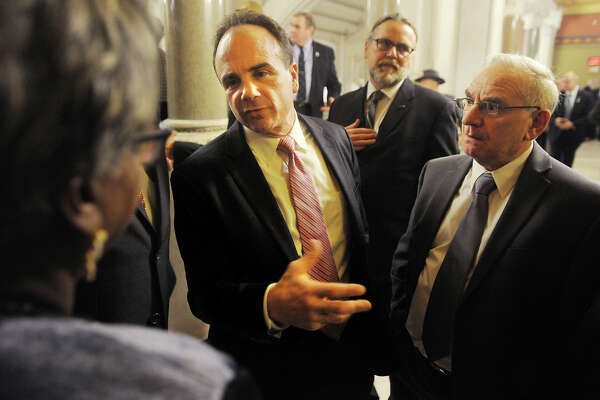 Bridgeport Mayor Joe Ganim talks with Sen. Marilyn Moore, left, outside the House of Representatives where he attended Gov. Dannel P. Malloy's budget address at the Capitol in Hartford, Conn. on Wednesday, February 3, 2016. Attending with Ganim is Bridgeport Democratic Town Committee Chair Mario Testa, right.