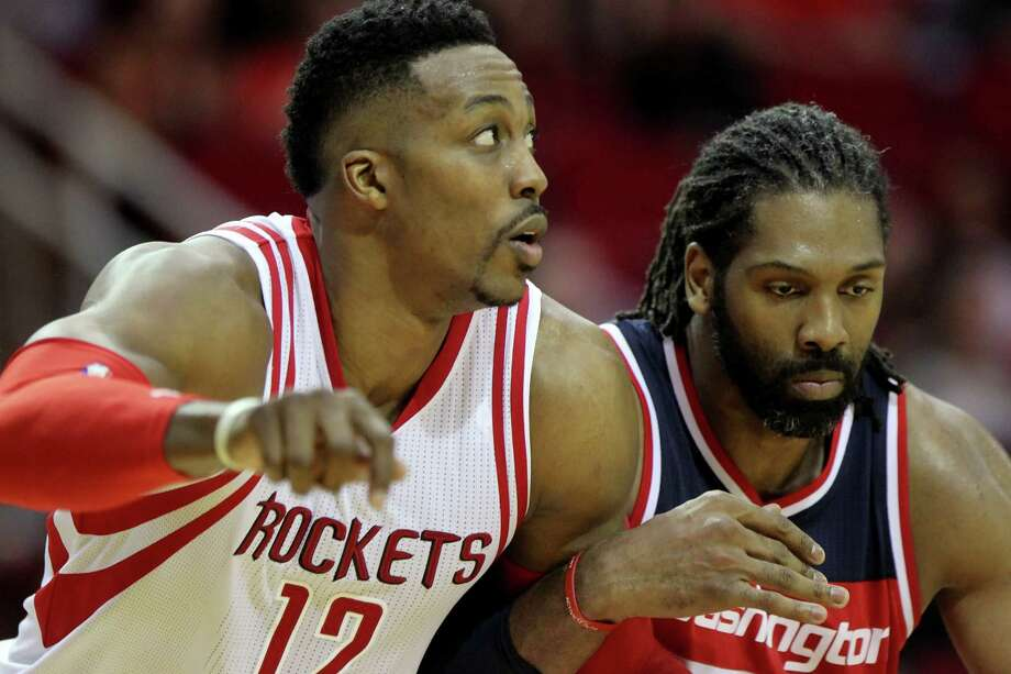 Dwight Howard, left, and the Wizards' Nene butted heads on Saturday night before Howard was ejected. Photo: Gary Coronado, Staff / © 2015 Houston Chronicle