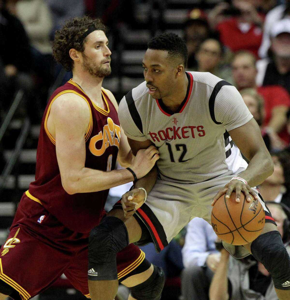 Cleveland Cavaliers forward Kevin Love (0) guards Houston Rockets center Dwight Howard (12) during the third quarter at the Toyota Center Friday, Jan. 15, 2016, in Houston. Rockets lost 77-91. ( Gary Coronado / Houston Chronicle )